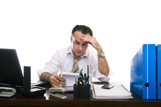Portraitf of a stressed & frustrated businessman